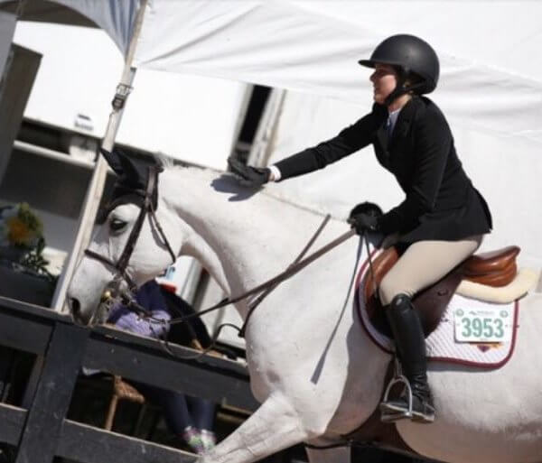 Equestrian on white horse