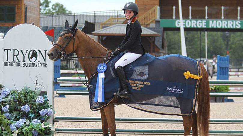Carly and horse winning medal award